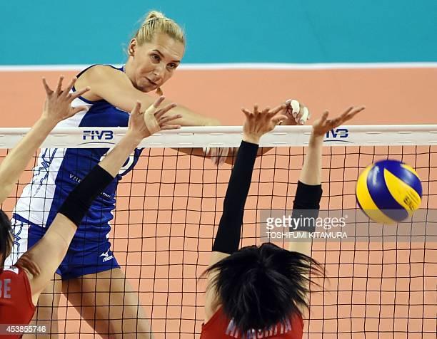 Russia's Iuliya Podskalnaya spikes the ball past Risa Shinnabe and Haruka Miyashita of Japan during their women's volleyball World Grand Prix final...