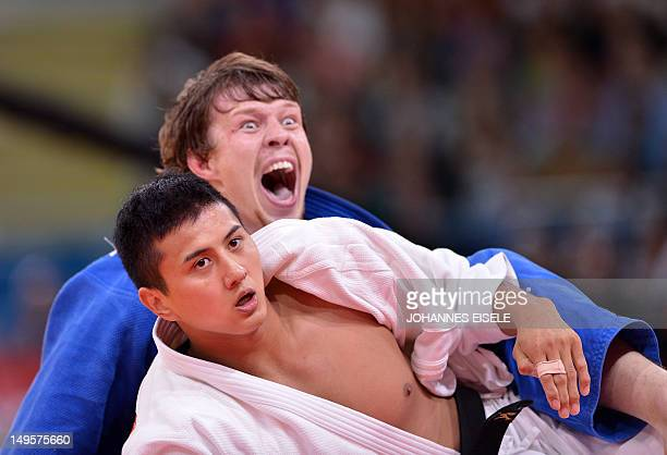 Russia's Ivan Nifontov as he wins against Japan's Takahiro Nakai during their men's 81kg judo contest bronze medal match of the London 2012 Olympic...