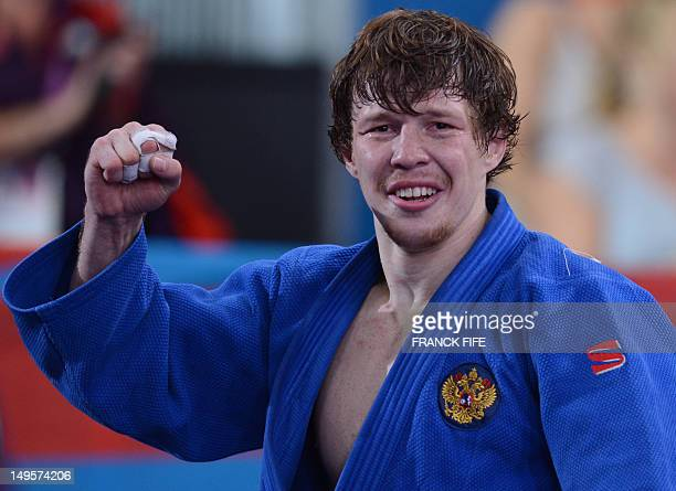 Russia's Ivan Nifontov celebrates after winning against Japan's Takahiro Nakai during their men's 81kg judo contest bronze medal match of the London...