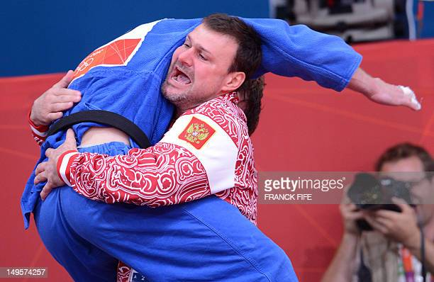 Russia's Ivan Nifontov celebrates with his coach after winning against Japan's Takahiro Nakai during their men's 81kg judo contest bronze medal match...