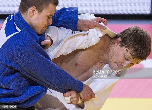 Russia's Ivan Nifontov competes with Czech Republic's Jaromir Musil during the mens qualification match in the 81kg category at the Judo World...