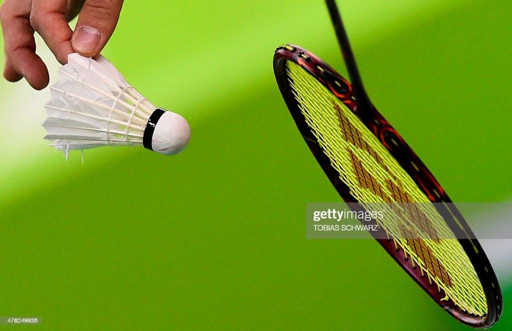Russia's Ivan Sozonov prepares to serve during the men's doubles badminton match against Azerbaijan at the 2015 European Games in Baku on June 24...