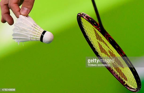 Russia's Ivan Sozonov prepares to serve during the men's doubles badminton match against Azerbaijan at the 2015 European Games in Baku on June 24...