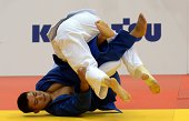 Russia's judoka Musa Mogushkov competes with Kazakhstan's Yertugan Torenov during the under 73 kg category competition for bronze medal at the IJF...