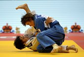 Russia's judoka Natalia Kuziutina competes with China's Yingnan Ma during the under 52 kg category competition for bronze medal at the IJF World Judo...