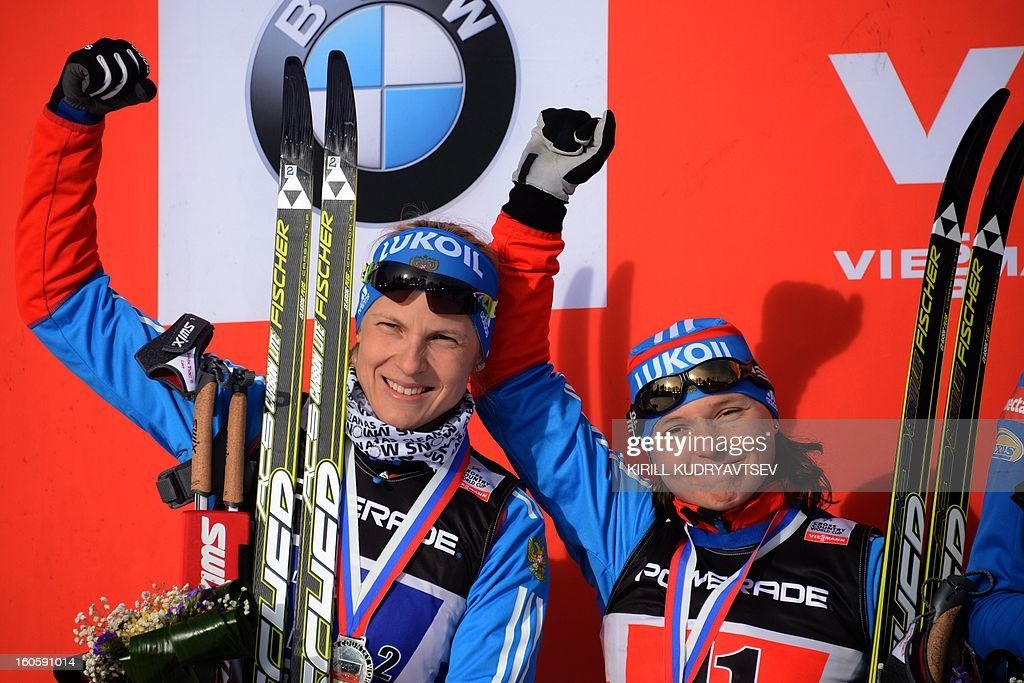 Russia's Julia Ivanova and Natalia Matveeva (R) react after 6 x 1,25 km Ladies' Classic Team Sprint of FIS Cross Country skiing World Cup at Laura Cross Country and Biathlon Center in Russian Black Sea resort of Sochi on February 3, 2013. Finland's Mona-Lisa Malvalehto and Anne Kylloenen took the first place ahead of Russia's Julia Ivanova and Natalia Matveeva and Canada's Perianne Jones and Daria Gaiazova.