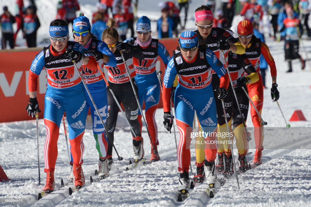 Russia's Julia Ivanova (front R) competes during 6 x 1,25 km Ladies' Classic Team Sprint of FIS Cross Country skiing World Cup at Laura Cross Country and Biathlon Center in Russian Black Sea resort of Sochi on February 3, 2013. Finland's Mona-Lisa Malvalehto and Anne Kylloenen took the first place ahead of Russia's Julia Ivanova and Natalia Matveeva and Canada's Perianne Jones and Daria Gaiazova. AFP PHOTO/KIRILL KUDRYAVTSEV