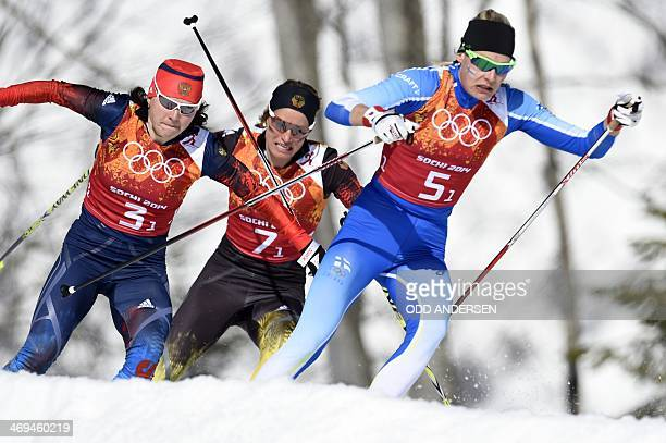 Russia's Julia Ivanova Germany's Nicole Fessel Finland's Anne Kylloenen compete in the Women's CrossCountry Skiing 4x5km Relay at the Laura...