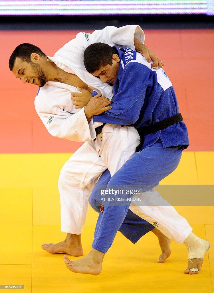 Russia's Kamal Khan-Magomedov (white) fights with Georgia's Lasha Shavdatuashvili (blue) during the final of the Judo European Championships in 66kg category for men in Budapest. Shavdatuashvili won the gold medal.