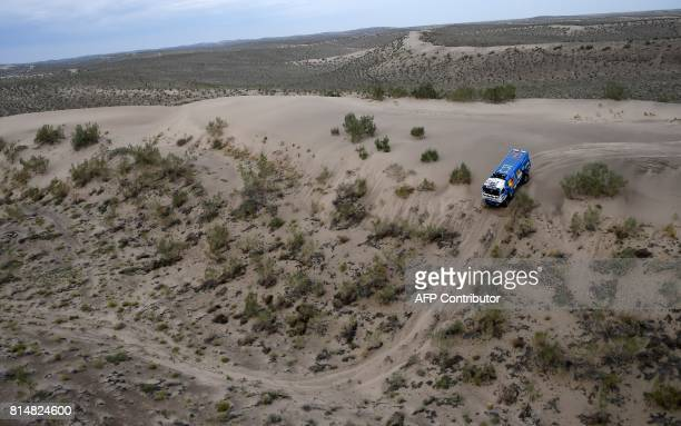 TOPSHOT Russia's Kamaz's driver Airat Mardeev codrivers Aydar Belyaev and Dmitry Svistunov compete during the Stage 8 of the Silk Way 2017 between...