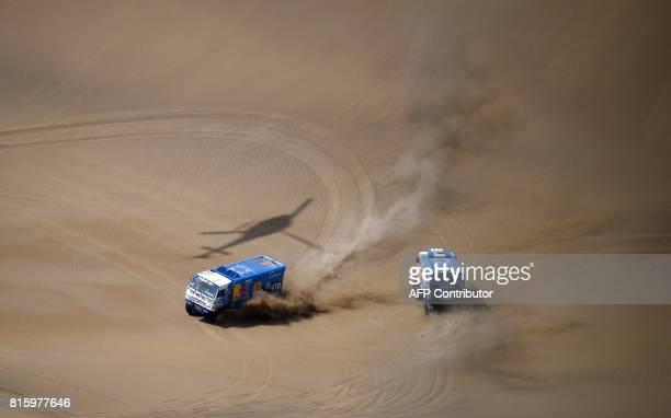 Russia's Kamaz's driver Ayrat Mardeev codrivers Aydar Belyaev and Dmitry Svistunov and Russia Kamaz's driver Dmitry Sotnikov codrivers Ruslan...