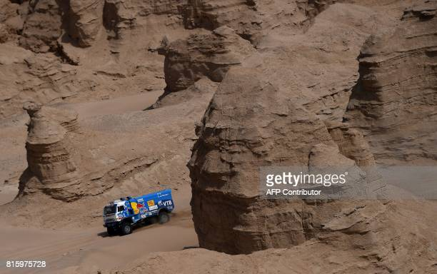 Russia's Kamaz's driver Ayrat Mardeev codrivers Aydar Belyaev and Dmitry Svistunov compete during the Stage 9 of the Silk Way 2017 between Urumqi and...