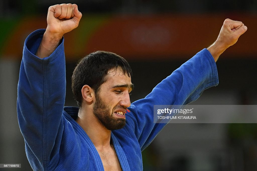 TOPSHOT Russia's Khasan Khalmurzaev celebrates after defeating United Arab Emirates's Sergiu Toma during their men's 81kg judo contest semifinal B...