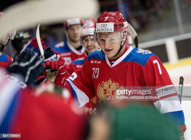 Russia's Kirill Kaprizov smiles after scoring his third goal during the ice hockey match between Sweden and Russia at the Sweden Hockey Games in...