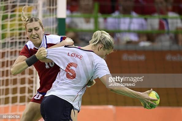 TOPSHOT Russia's left back Olga Akopian vies with Norway's pivot Heidi Loke during the women's semifinal handball match Norway vs Russia for the Rio...