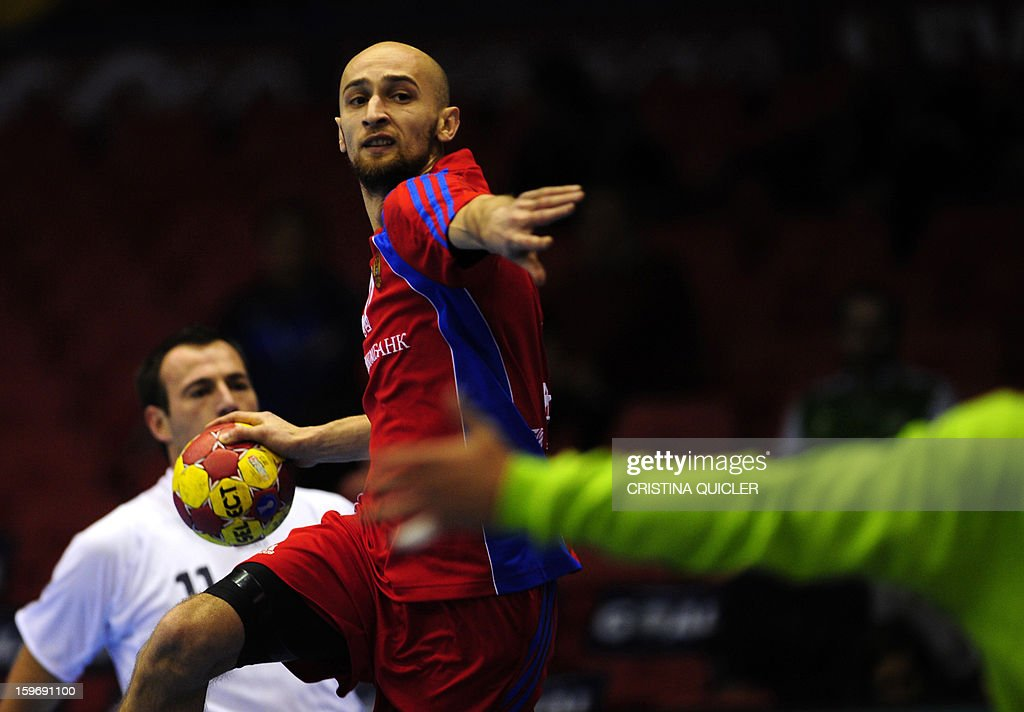 Russia's left wing Timur Dibirov (C) vies with Chile's goalkeeper Felipe Barrientos (R) and Chile's right wing Felipe Maurin (L) during the 23rd Men's Handball World Championships preliminary round Group B match Russia vs Chile at the Palacio de Deportes San Pablo in Sevilla on January 18, 2013.