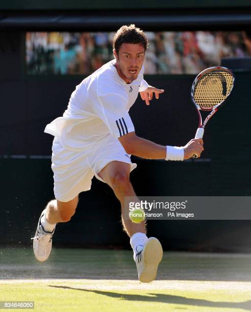 Russia's Marat Safin in action against Spain's Feliciano Lopez during the Wimbledon Championships 2008 at the All England Tennis Club in Wimbledon
