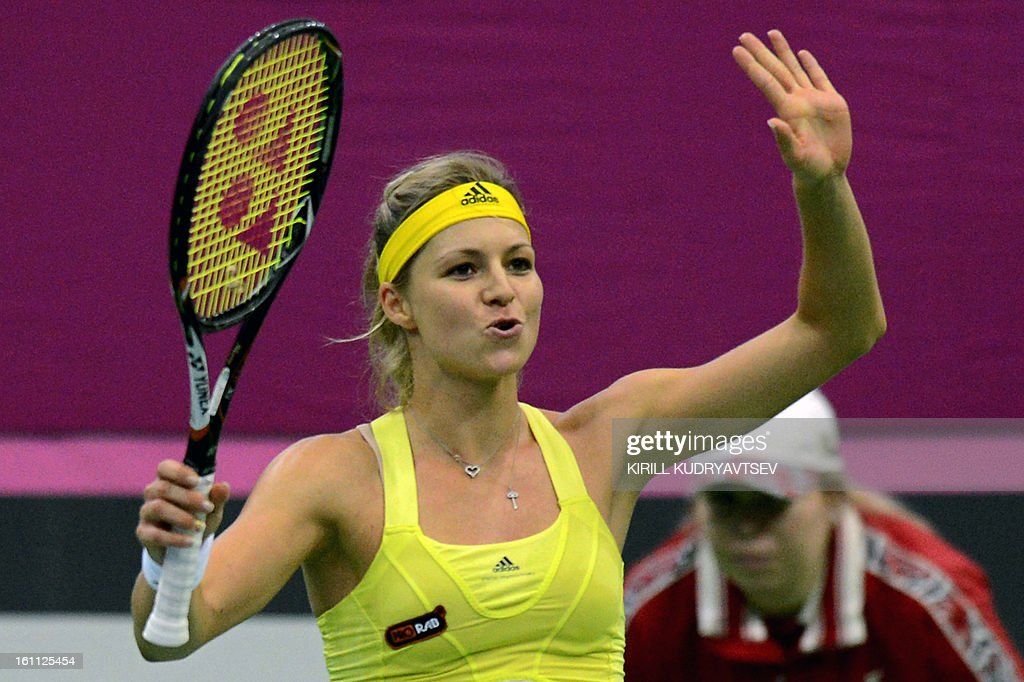 Russia's Maria Kirilenko celebrates her victory over Japan's Kimiko Date-Krumm during the International Tennis Federation Fed Cup quarterfinal match between Russia and Japan in Moscow on February 9, 2013.