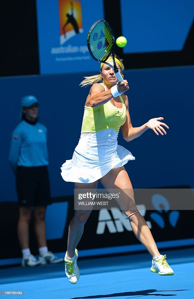 Russia's Maria Kirilenko hits a return against Belgium's Yanina Wickmayer during their women's singles match on day six of the Australian Open tennis tournament in Melbourne on January 19, 2013.