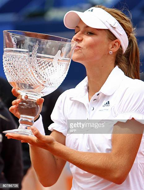 Russia's Maria Kirilenko kisses the trophy during the podium ceremony at the Estoril Open after beating Czech Republic's Iveta Benesova 64 and 62 at...