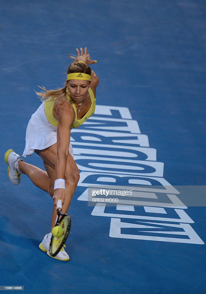 Russia's Maria Kirilenko plays a return during her women's singles match against Serena Williams of the US on the eighth day of the Australian Open tennis tournament in Melbourne on January 21, 2013.
