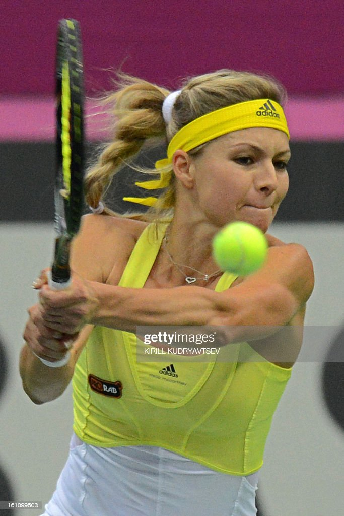 Russia's Maria Kirilenko returns a ball to Japan's Kimiko Date-Krumm during the International Tennis Federation Fed Cup quarterfinal match between Russia and Japan in Moscow on February 9, 2013.