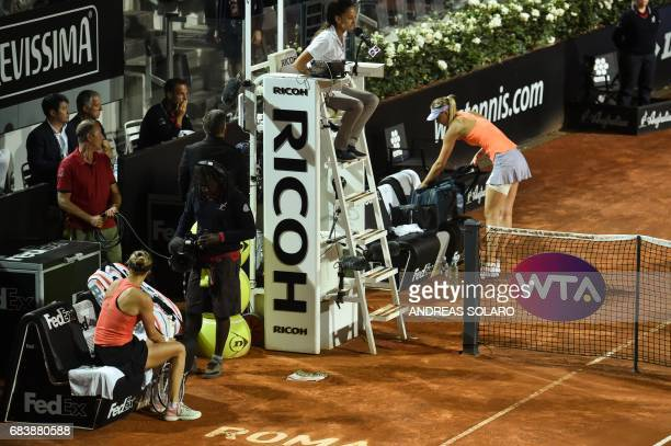 Russia's Maria Sharapova abandons her match against Mirjana LucicBaroni of Croatia during the Rome ATP Tennis Open tournament on May 16 2017 at the...