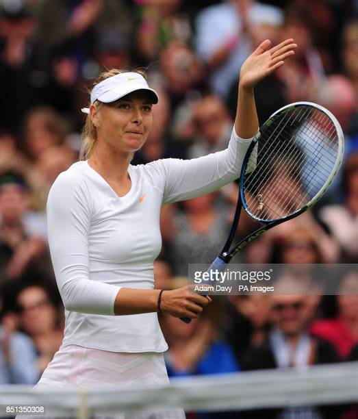 Russia's Maria Sharapova celebrates defeating France's Kristina Mladenovic during day one of the Wimbledon Championships at The All England Lawn...