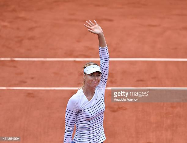 Russia's Maria Sharapova celebrates victory during her Women's Singles match against her compatriot Vitalia Diatchenko during their second round...