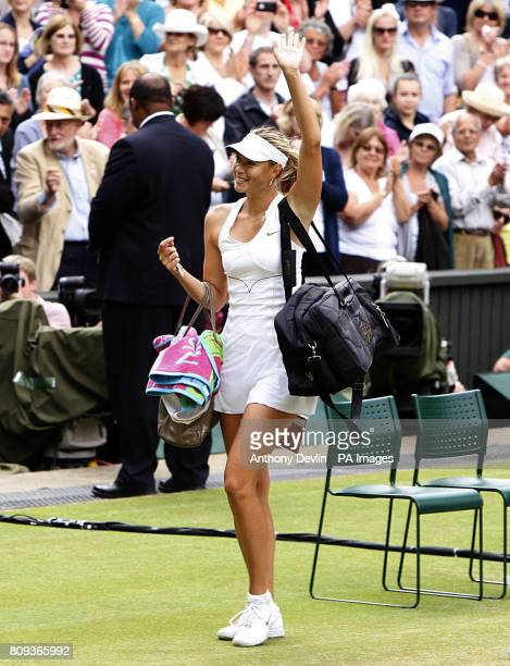 Russia's Maria Sharapova celebrates winning her semifinal match against Germany's Sabine Lisicki on day ten of the 2011 Wimbledon Championships at...