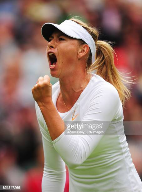 Russia's Maria Sharapova celebrates winning the first set from France's Kristina Mladenovic during day one of the Wimbledon Championships at The All...