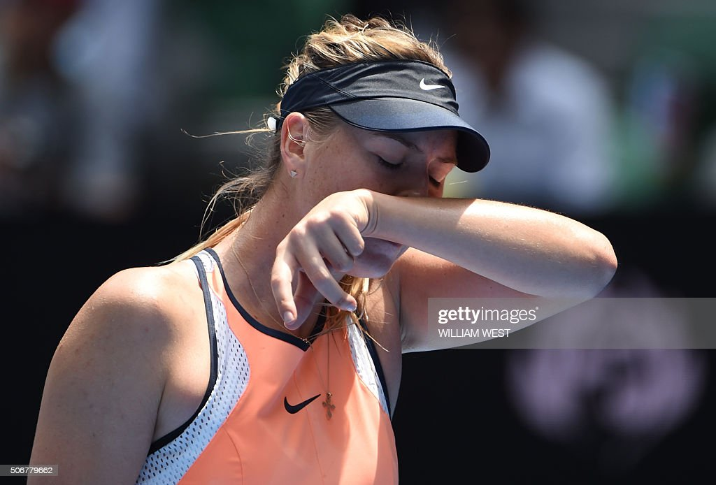 Russia's Maria Sharapova gestures during her women's singles match against Serena Williams of the US on day nine of the 2016 Australian Open tennis tournament in Melbourne on January 26, 2016.