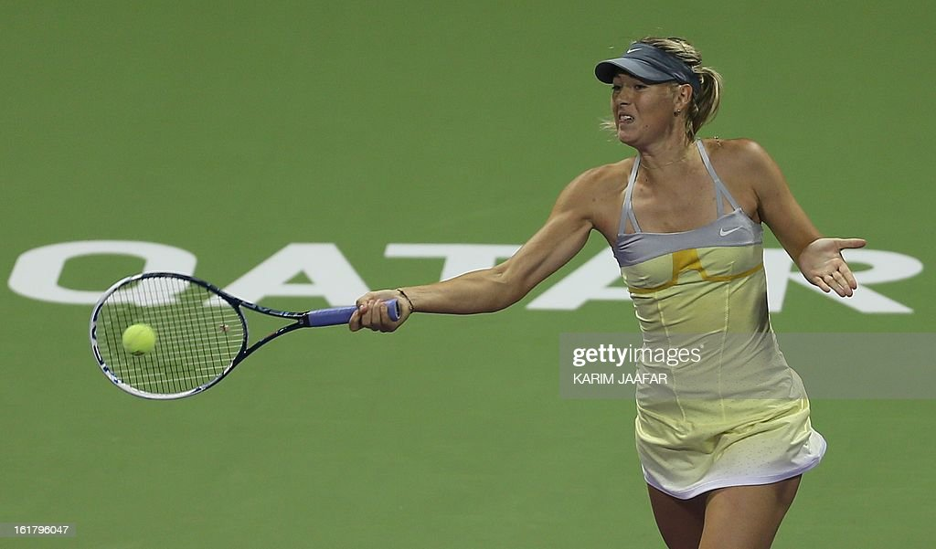Russia's Maria Sharapova hits a return to US Serena Williams during their WTA Qatar Open semi-final tennis match on February 16, 2013 in the Qatari capital, Doha. Williams won 6-3,6-2.
