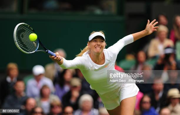 Russia's Maria Sharapova in action against France's Kristina Mladenovic during day one of the Wimbledon Championships at The All England Lawn Tennis...