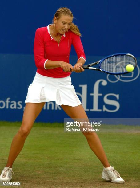 Russia's Maria Sharapova in action against France's Tatiana Golovin