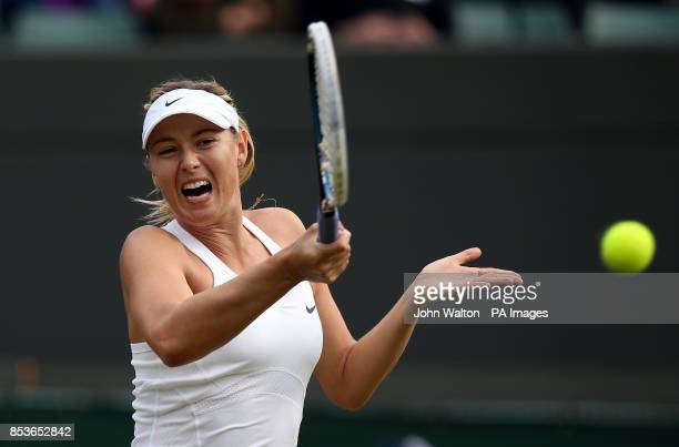 Russia's Maria Sharapova in action against Switzerland's Timea Bacsinszky during day four of the Wimbledon Championships at the All England Lawn...
