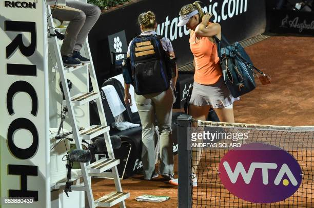 TOPSHOT Russia's Maria Sharapova leaves the court during her match against Mirjana LucicBaroni of Croatia at the Rome ATP Tennis Open tournament on...