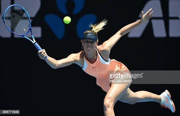 Russia's Maria Sharapova plays a forehand return during her women's singles match against Serena Williams of the US on day nine of the 2016...