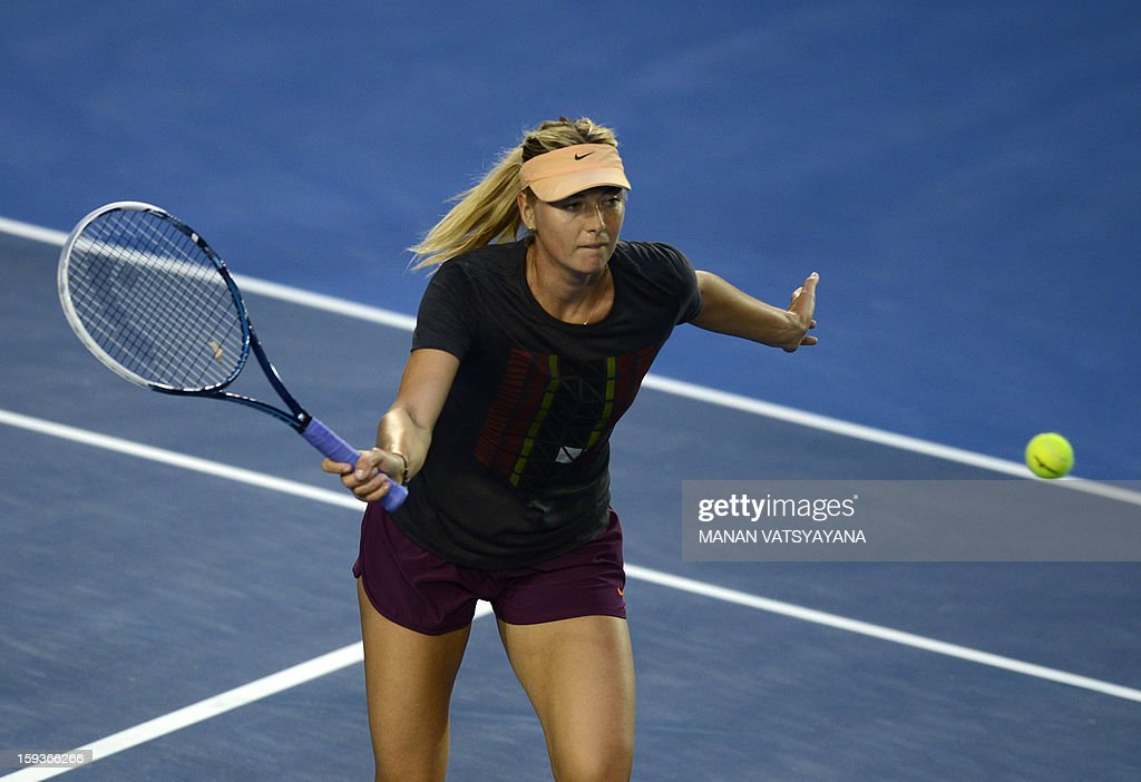 Russia's Maria Sharapova plays a return during a practice session ahead of the 2013 Australian Open tennis tournament on January 13, 2013.