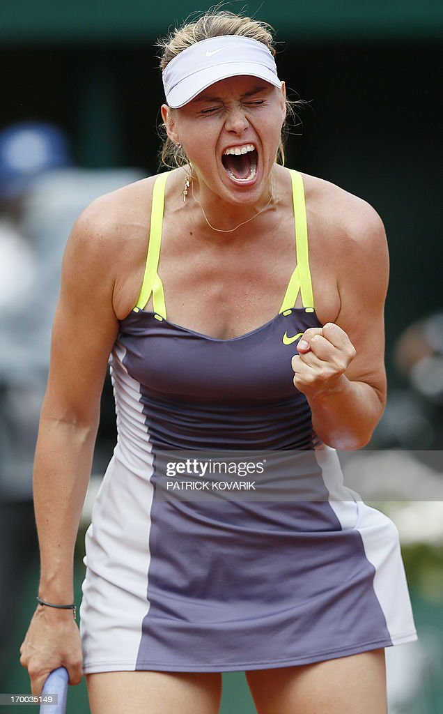Russia's Maria Sharapova reacts after a point against Belarus' Victoria Azarenka during a French tennis Open semi final match at the Roland Garros stadium in Paris on June 6, 2013. AFP PHOTO / PATRICK KOVARIK