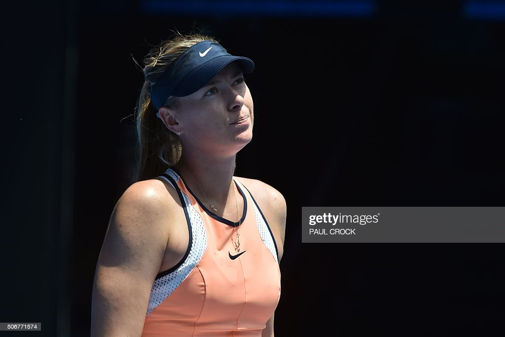 Russia's <a gi-track='captionPersonalityLinkClicked' href=/galleries/search?phrase=Maria+Sharapova&family=editorial&specificpeople=157600 ng-click='$event.stopPropagation()'>Maria Sharapova</a> reacts during her women's singles match against Serena Williams of the US on day nine of the 2016 Australian Open tennis tournament in Melbourne on January 26, 2016.