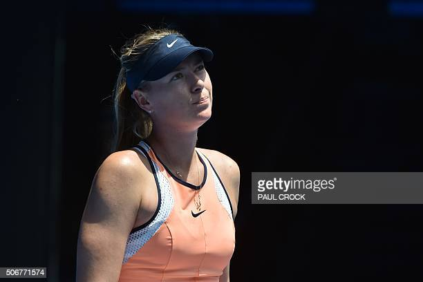 Russia's Maria Sharapova reacts during her women's singles match against Serena Williams of the US on day nine of the 2016 Australian Open tennis...