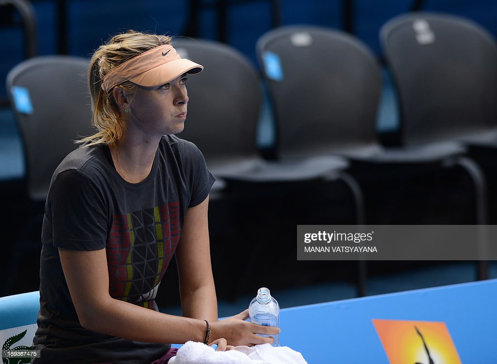 Russia's Maria Sharapova rests during a practice session ahead of the 2013 Australian Open tennis tournament in Melbourne on January 13, 2013. AFP PHOTO/MANAN VATSYAYANA IMAGE STRICTLY RESTRICTED TO EDITORIAL USE - STRICTLY NO COMMERCIAL USE