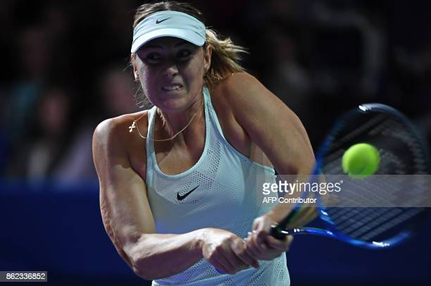 Russia's Maria Sharapova returns the ball to Slovakia's Magdalena Rybarikova during the women's singles first round tennis match at the Kremlin Cup...