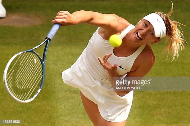 Russia's Maria Sharapova returns to Germany's Angelique Kerber during their women's singles fourth round match on day eight of the 2014 Wimbledon...