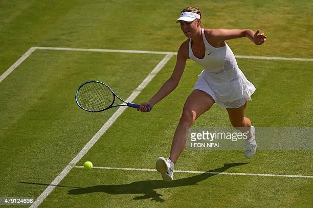 Russia's Maria Sharapova returns to Netherlands' Richel Hogenkamp during their women's singles second round match on day three of the 2015 Wimbledon...