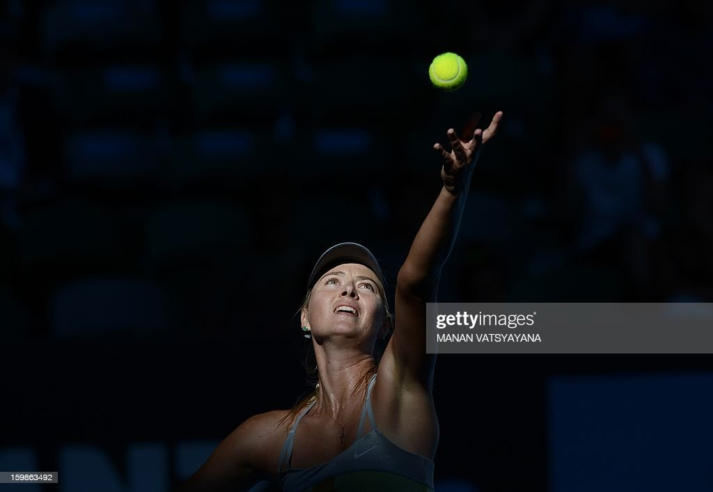 Russia's Maria Sharapova serves against Russia's Ekaterina Makarova during their women's singles match on day nine of the Australian Open tennis tournament in Melbourne on January 22, 2013. AFP PHOTO / MANAN VATSYAYANA IMAGE STRICTLY RESTRICTED TO EDITORIAL USE - STRICTLY NO COMMERCIAL USE