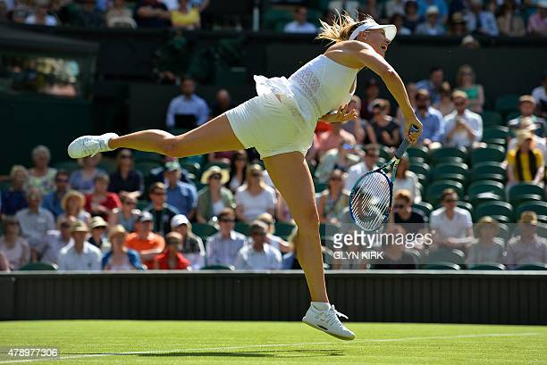 Russia's Maria Sharapova serves to Britain's Johanna Konta during their women's singles first round match on day one of the 2015 Wimbledon...