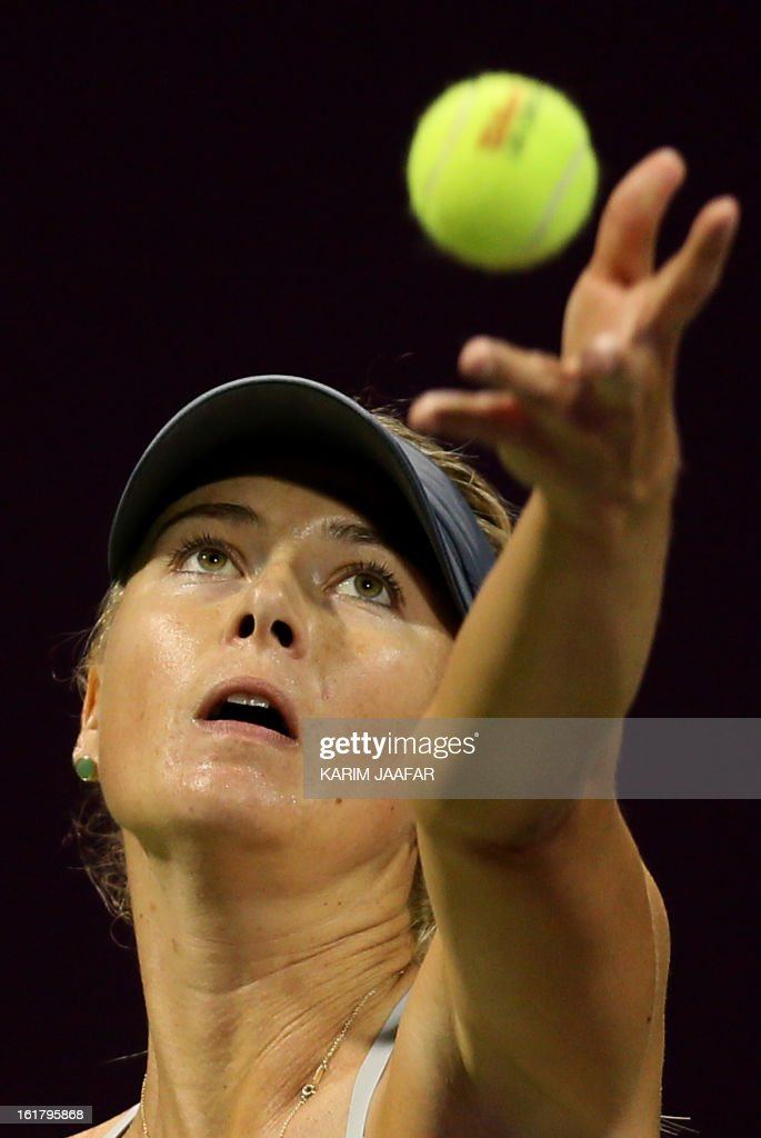 Russia's Maria Sharapova serves to US Serena Williams during their WTA Qatar Open semi-final tennis match on February 16, 2013 in the Qatari capital, Doha. Williams won 6-3,6-2.