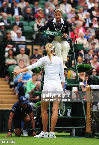 Russia's Maria Sharapova speaks with umpire Mariana Alves in her match against France's Kristina Mladenovic during day one of the Wimbledon...